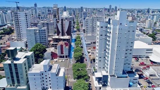 Cidade vista do alto. Só é possível ver prédios até o final da linha do horizonte