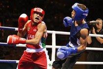 Robenilson Vieira em combate com Anvar Yunusov, do Tajiquistão, nos jogos de Beijing 2008. Foto: Washington Alves / COB