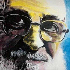 Mural pintado com figura de Paulo Freire