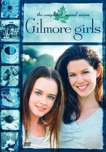 Duas mulheres de cabelos longos: uma filha ao lado de uma mãe
