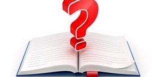 livro aberto com ponto de interrogação no meio