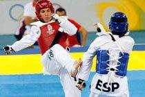 Márcio Wenceslau (vermelho) durante combate com o espanhol Juan Ramos (Categoria -58 KG). Foto: Washington Alves / Divulgação COB